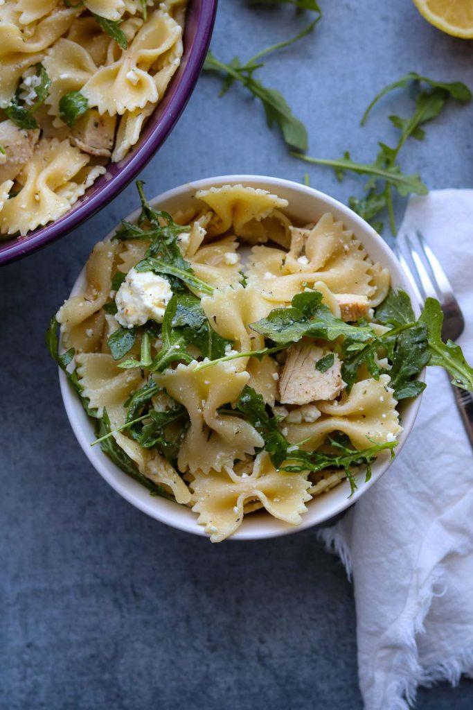 Lemon Arugula pasta salad in bowl with fork