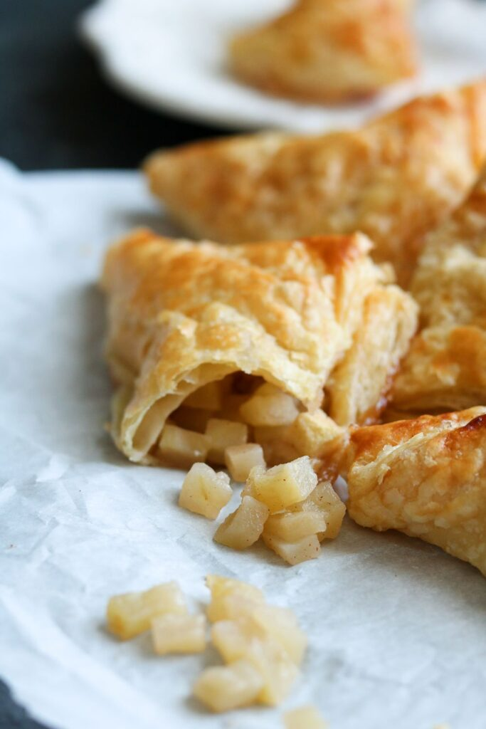 puff pastries with apple on paper
