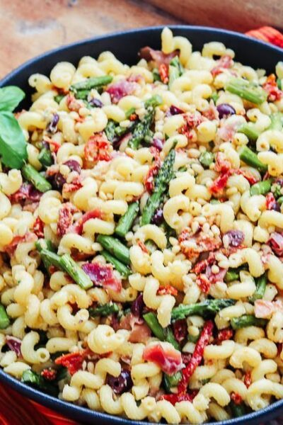 Mediterranean Pasta Salad in bowl with napkin
