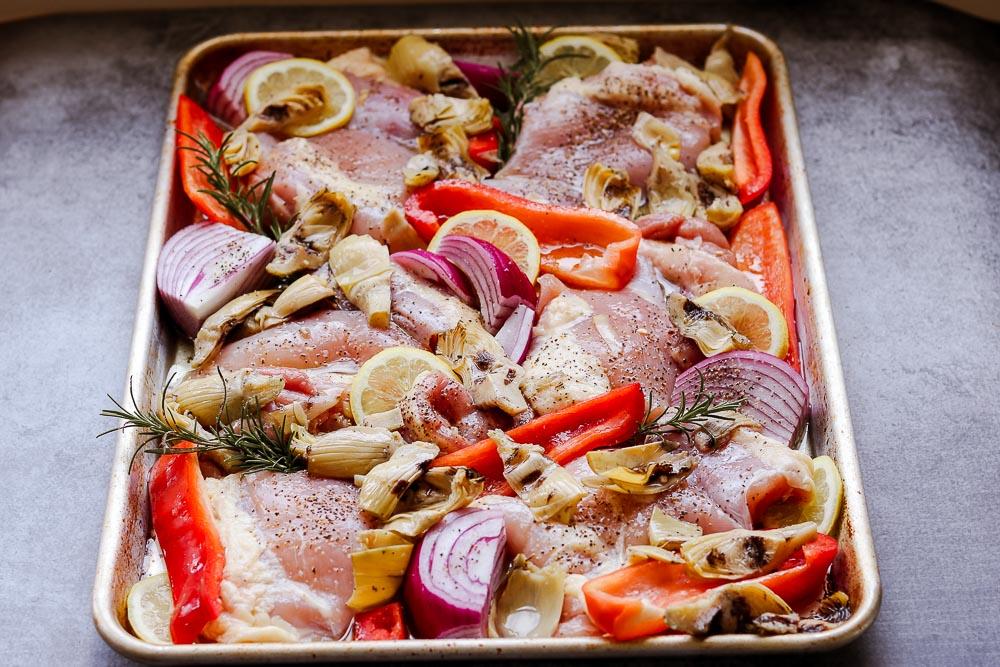 raw chicken on sheet pan