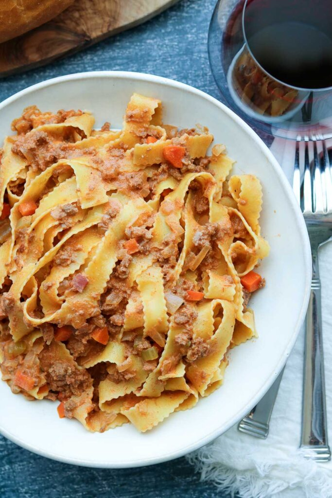 Ragu Bolognese Sauce plated with Reginelle Noodles