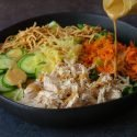 dressing poured onto chinese chicken salad