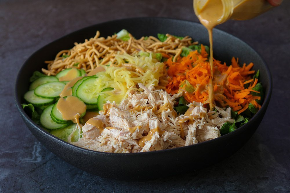 dressing poured onto the classic chinese chicken salad