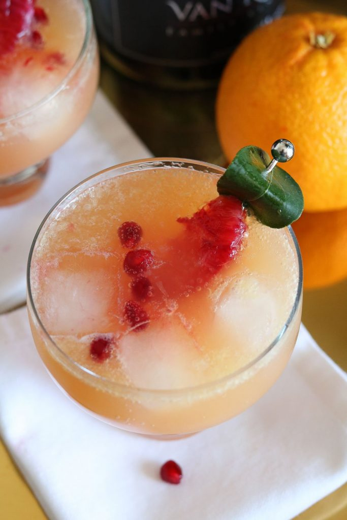 top view of pomegranate blood orange cocktail with garnish