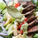 rich and spicy avocado dressing on steak salad
