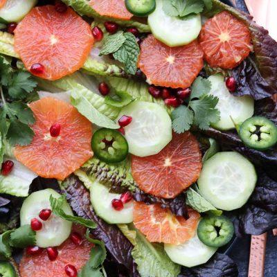 Winter citrus salad with serving utensils