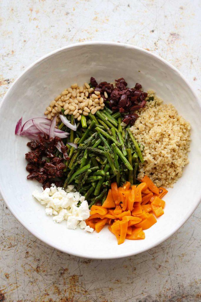 warm quinoa ingredients in white bowl