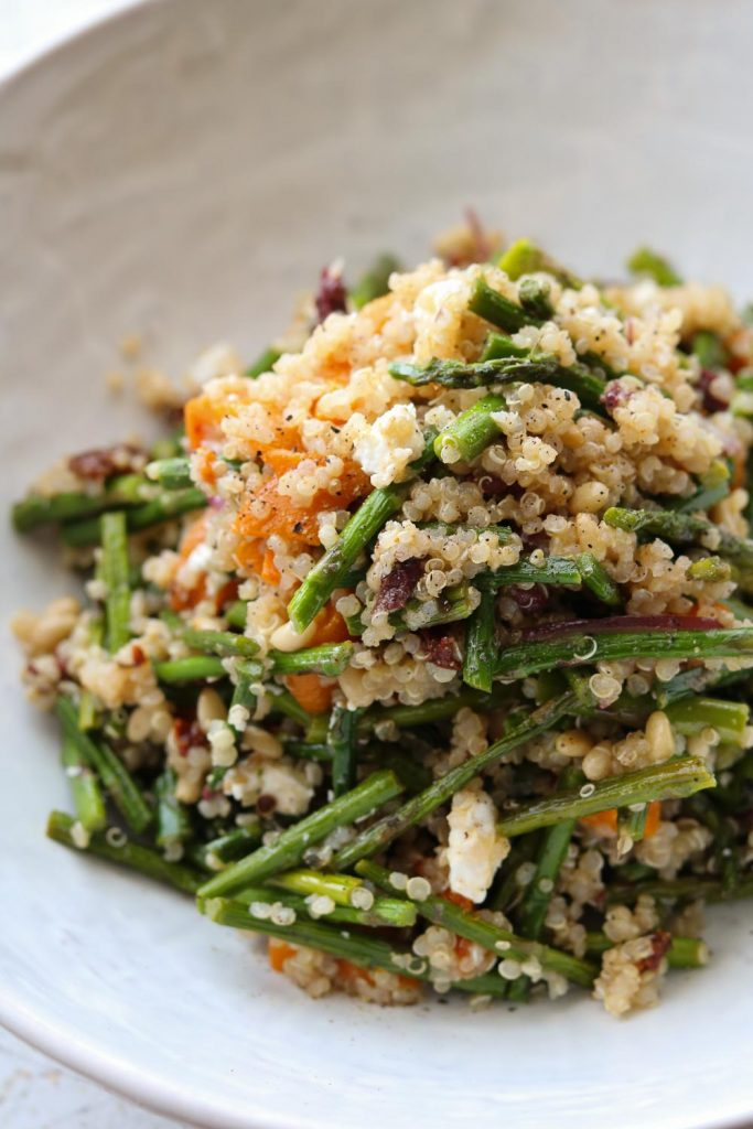 warm quinoa roasted asparagus and peppers plated in bowl