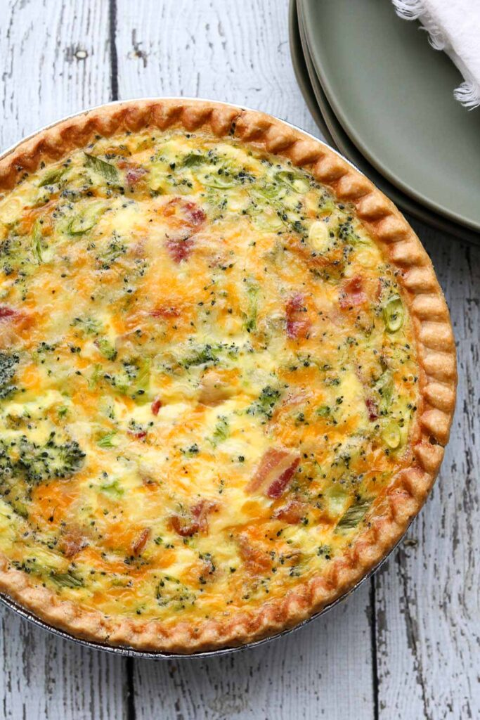 deep dish bacon and broccoli quiche with serving plates
