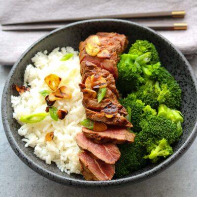 lemon soy flat iron steak with crispy garlic with chopsticks
