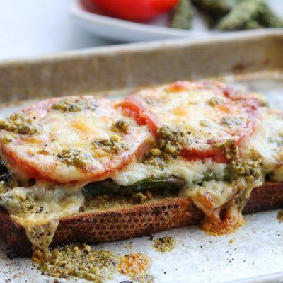roasted asparagus tomato pesto melt on baking sheet
