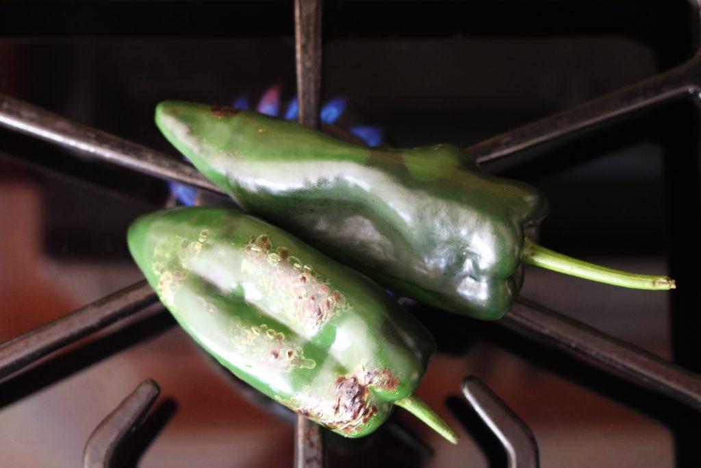 poblanos roasting on stovetop