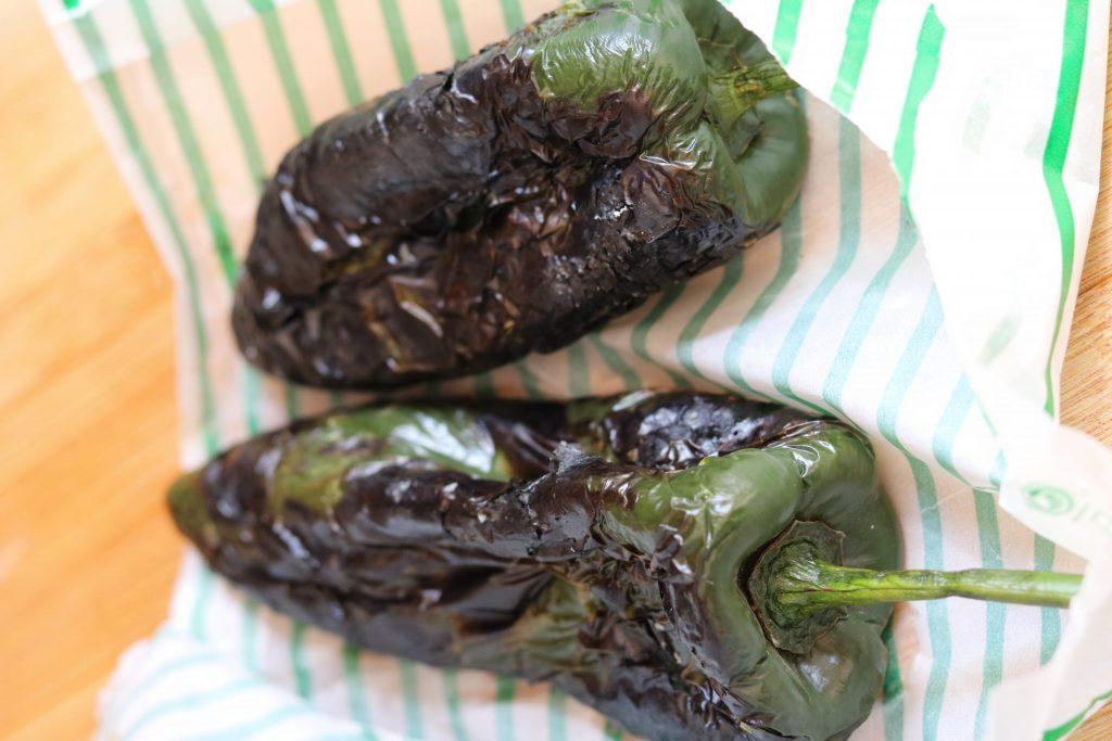 roasted poblanos ready to peel