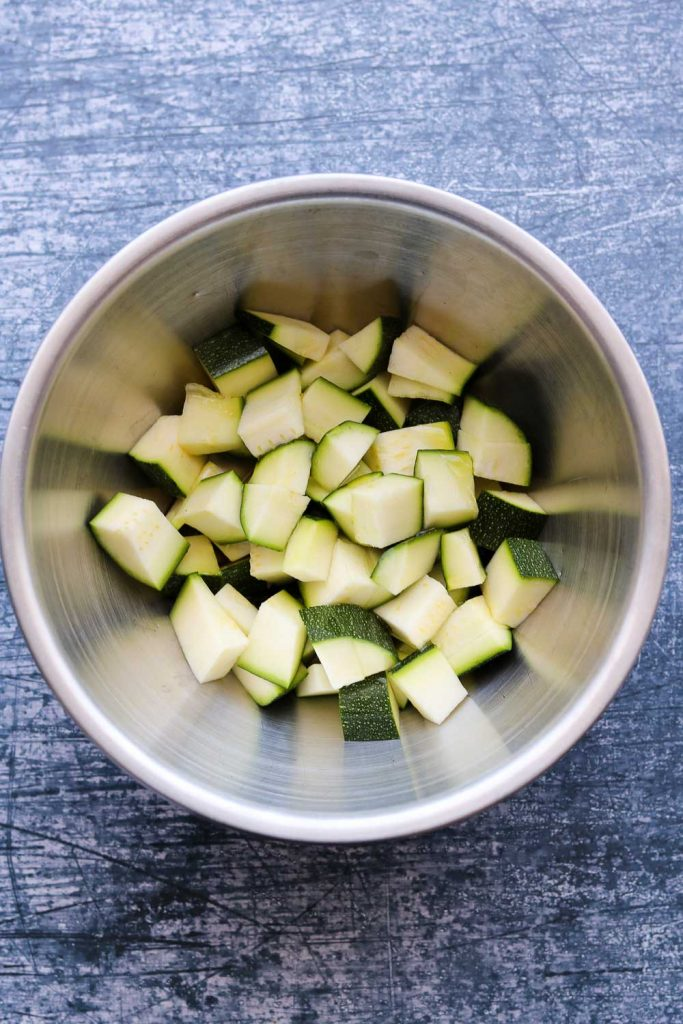 raw zucchini chopped in bowl