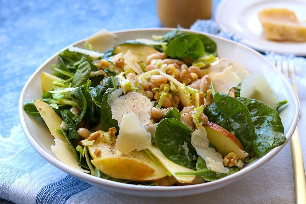 apple spinach white bean salad plated with fork