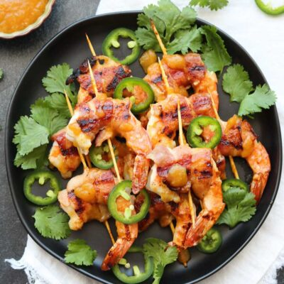 chutney glazed bacon wrapped shrimp plated and garnished