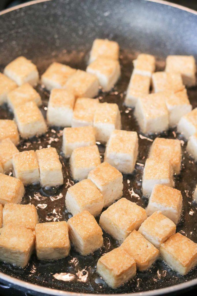 frying tofu cubes