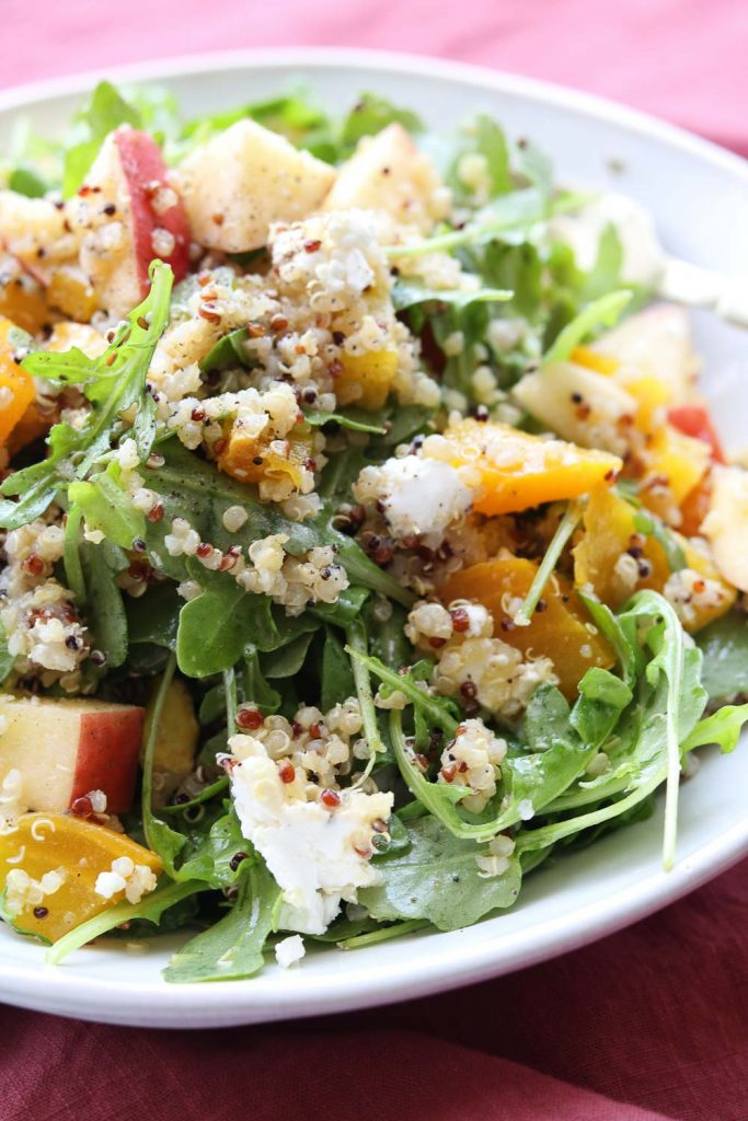 close up of roasted golden beet arugula apple salad