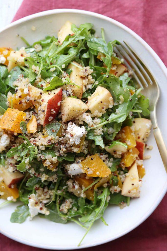 roasted golden beet arugula apple salad in bowl with fork