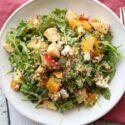 square image of roasted golden beet arugula apple salad