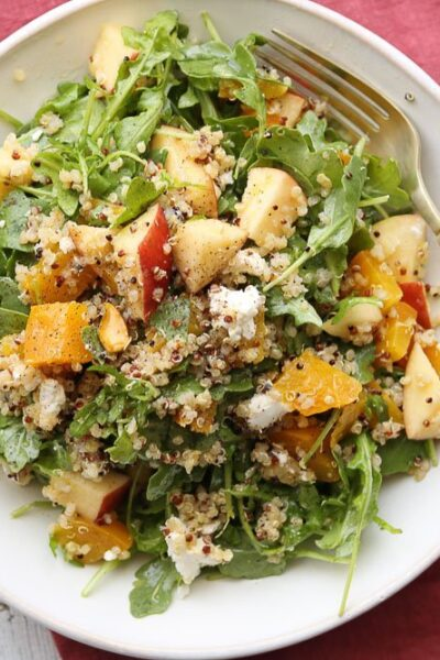 roasted golden beet quinoa salad on plate with fork