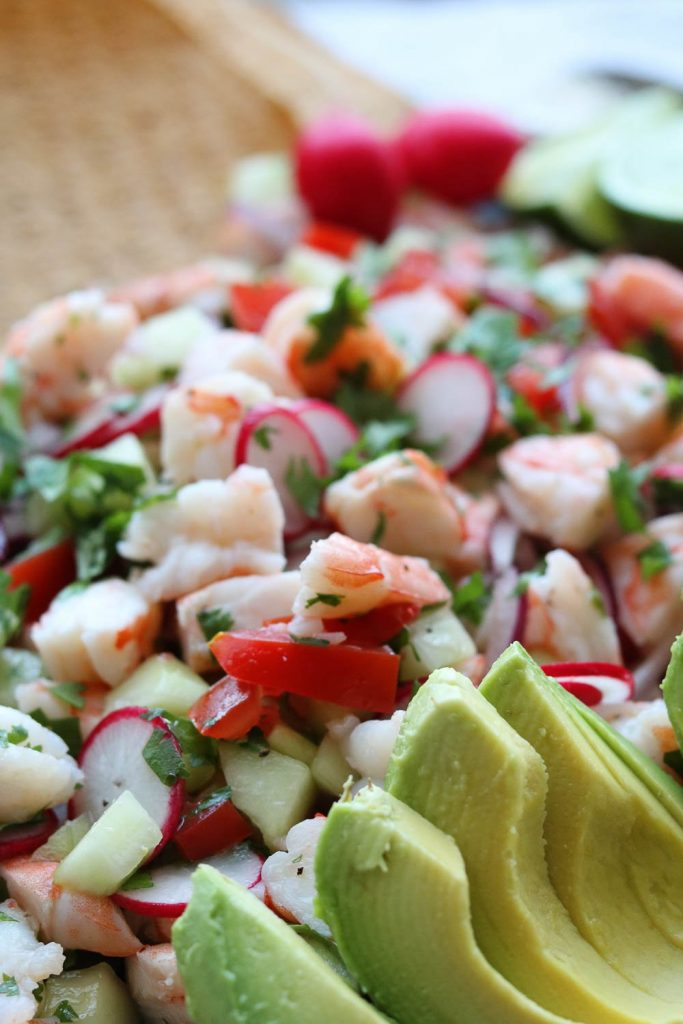 side view of shrimp ceviche style tostadas with avocado