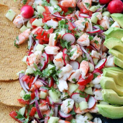 Shrimp ceviche in large platter with avocado and tostadas
