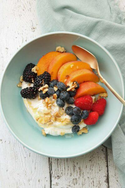summer fruit yogurt bowl with spoon