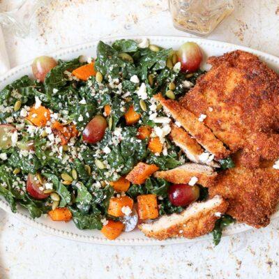 chicken schnitzel and kale autumn salad horizontal with serving utensils