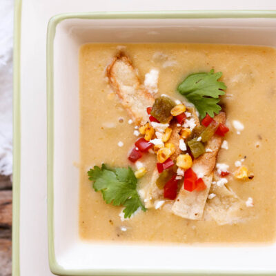 creamy potato hatch chile soup in bowl with napkin