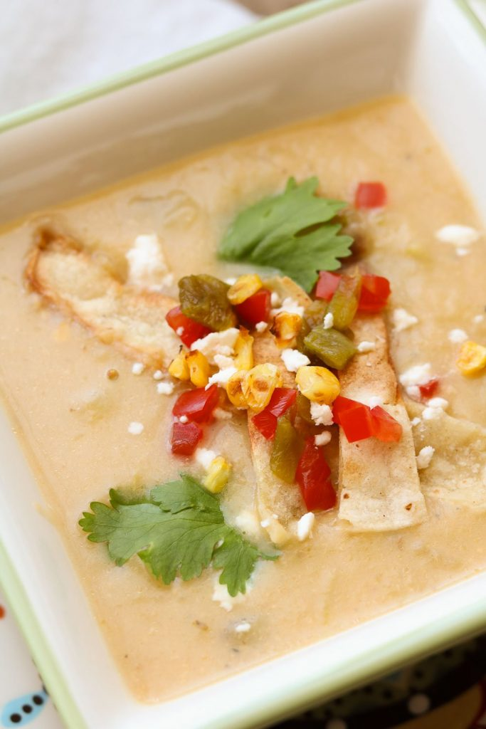 creamy potato hatch Chile soup with toppings