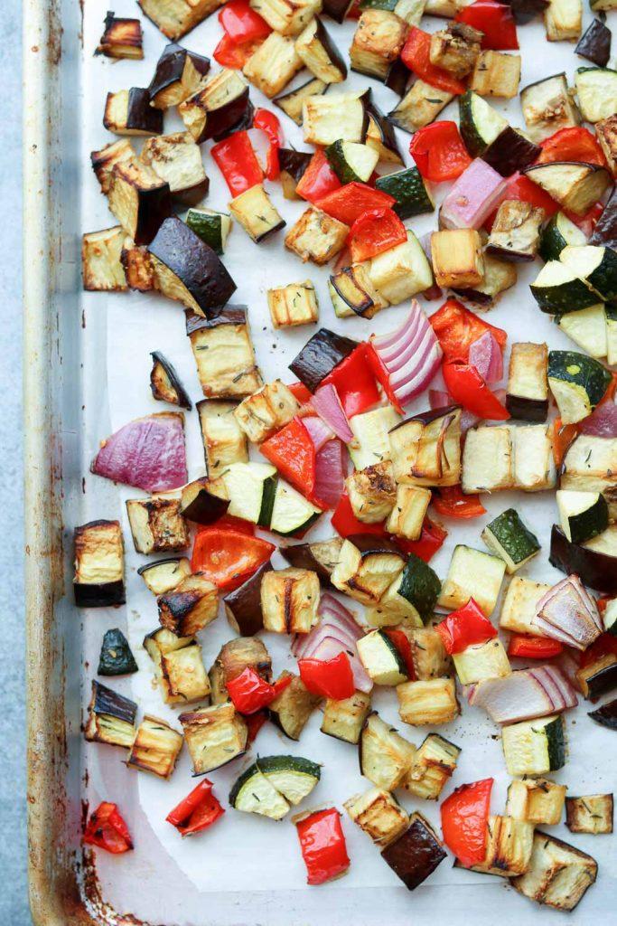 roasted vegetables on rimmed baking sheet