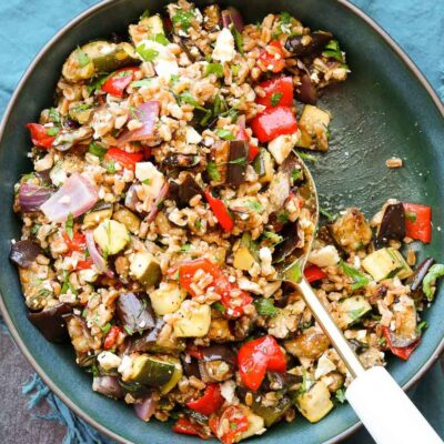 square size balsamic roasted vegetable grain salad with serving spoon