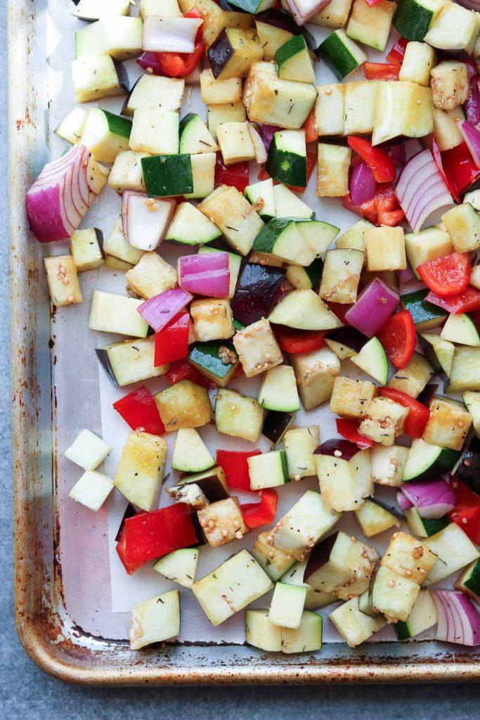 cubed veggies on rimmed baking sheet